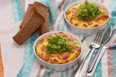 Omelet. The baked omelet with sausage, lettuce leaves and rye bread Royalty Free Stock Photos