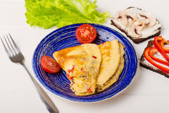 Omelet in a blue plate Royalty Free Stock Images