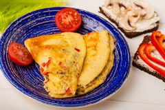 Omelet in a blue plate Stock Photo