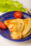 Omelet in a blue plate Stock Photos