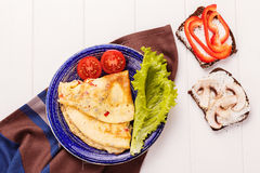 Omelet in a blue plate Stock Photography