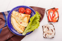 Omelet in a blue plate Royalty Free Stock Photo