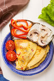 Omelet in a blue plate Stock Image