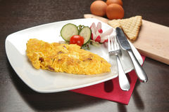 Omelet breakfast. With vegetables on plate Stock Photo