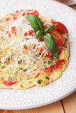 Omelet with cheese and cherry tomato Stock Image