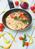 Omelet with cheese and cherry tomato Royalty Free Stock Photography