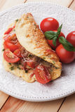 Omelet with cheese and cherry tomato. Served on a plate Royalty Free Stock Photo