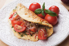 Omelet with cheese and cherry tomato. Served on a plate Royalty Free Stock Photography