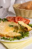 Omelet with cheese and fresh herbs on the table Stock Photography
