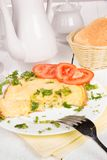 Omelet with cheese and fresh herbs on the table Royalty Free Stock Photography