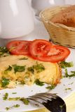 Omelet with cheese and fresh herbs on the table Stock Image