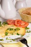 Omelet with cheese and fresh herbs on the table Royalty Free Stock Images