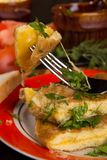 Omelet with cheese and fresh herbs on the table Stock Images