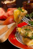 Omelet with cheese and fresh herbs on the table Stock Photos