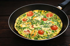Omelet with cherry tomatoes, sweet pepper and herbs for 2 persons. Stock Photography