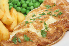 Omelet and Chips. Cheese omelet with chips and peas Stock Photo