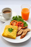 Omelet with coffee. Coffee and orange juicewith omelet and sausage stock images