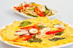 Omelet with cooked seafood and greens Royalty Free Stock Photo