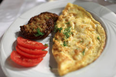 Omelet with cutlet and sliced tomatoes Royalty Free Stock Photos