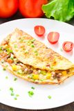 Omelet with diced vegetables Royalty Free Stock Images