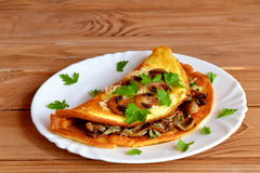 Omelet with filling on a plate Royalty Free Stock Images