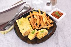 Omelet and french fries Stock Photography