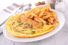 Omelet and french fries Royalty Free Stock Photo