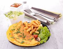 Omelet and french fries Royalty Free Stock Photos