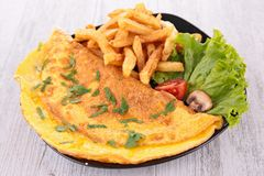 Omelet and french fries Stock Photos