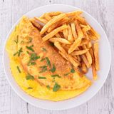 Omelet and french fries Stock Image