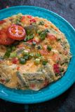 Omelet, fried chicken eggs. With fresh vegetables Royalty Free Stock Photography
