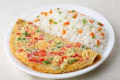Omelet with fried rice. Tomato omelet with fried vegetable rice Stock Photos