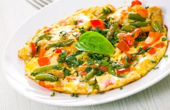 Omelet with green bean royalty free stock image