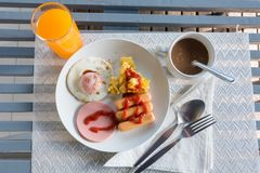 Omelet, grilled sausages, tomato on a white plate.breakfast. Omelet, grilled sausages, tomato on a white plate.breakfast Royalty Free Stock Images