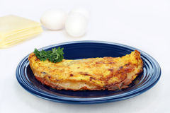 Omelet of ham and cheese with copy space. Royalty Free Stock Photos