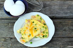 Omelet with ham, cheese and peas Royalty Free Stock Photos