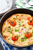Omelet with ham and cherry tomatoes Stock Images