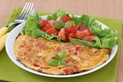 Omelet with ham and salad Royalty Free Stock Photo