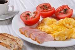 Omelet with ham and tomato and coffee Stock Image