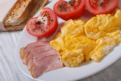 Omelet with ham and tomatoes and croutons Royalty Free Stock Image