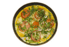 Omelet with herbs and tomatoes Royalty Free Stock Photo