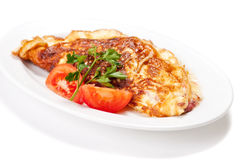Omelet with herbs and tomatoes Stock Photo
