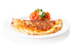 Omelet with herbs and tomatoes Stock Photography