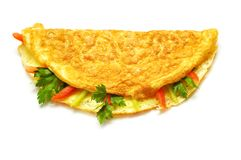 Omelet with herbs and tomatoes Royalty Free Stock Photography