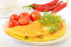 Omelet with herbs and vegetables Royalty Free Stock Photography