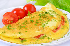 Omelet with herbs and vegetables Stock Images