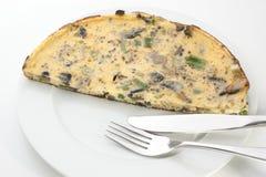 Omelet met paddestoel en de lenteui Stock Afbeelding