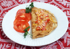 Omelet met tomaten Stock Foto's