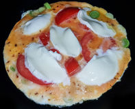 Omelet with Mozzarella nd tomatos stock photography