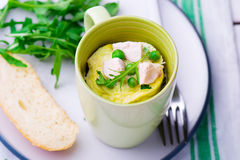 Omelet in a  mug prepared in microwave Stock Photography